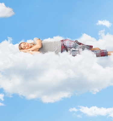 Woman floating on a cloud