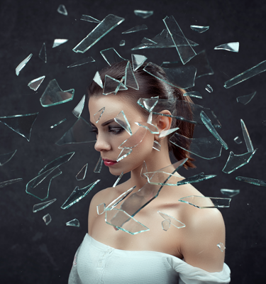woman with glass shattered around her